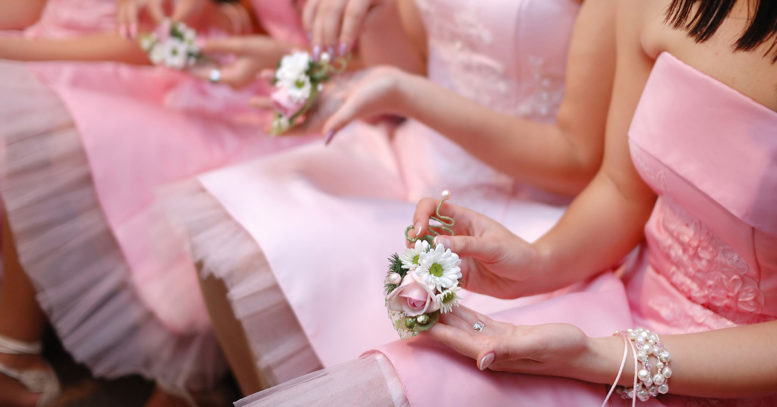 40752954 - row of bridesmaids with bouquets at wedding ceremony